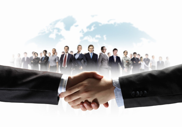 business handshake against white background and standing busines